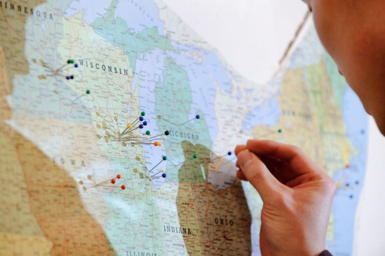 Sticking push pins in a map